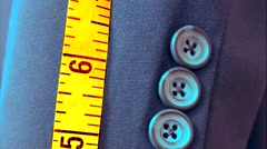 Close up of blue men's suit jacket and tailor's tape measure. Stock Footage