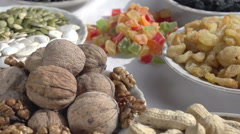 Different kinds of nuts and dried fruit Stock Footage