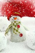 Happy snowman on the snow - stock photo