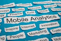 Word Mobile Analytics On Piece Of Paper Salient Among Other Related Keywords - stock photo
