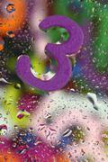 Number three on abstract colorful drops background Stock Photos