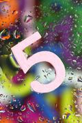 Number five on abstract colorful drops background - stock photo