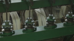 Silk thread being spun on wheels in Siem Reap Cambodia Stock Footage
