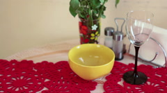 Still life with glass, plate and flowers on the kitchen table Stock Footage