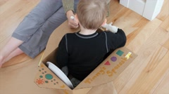 A mother makes a spaceship with her toddler Stock Footage