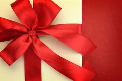 Close up of gift box on red background Stock Photos