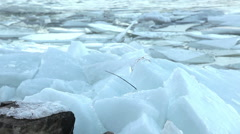 Cracked ice on riverbank during floating, camera focusing Stock Footage