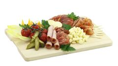 Meat delicatessen plate with cheese Stock Photos