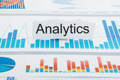 Torn Paper With  Text Analytics On Bar Graph Report - stock photo