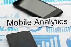 Mobile Phone And Torn Paper With  Text Analytics On Graph - stock photo