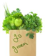 Fresh green vegetables and fruits in a paper grocery bag Stock Photos