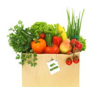 Paper bag full with fruits and vegetables. Stock Photos