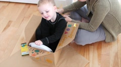 A mother making a spaceship with her toddler boy Stock Footage