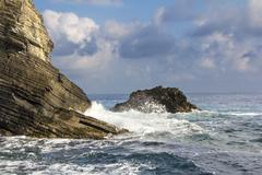 Waves and Cliffs - stock photo