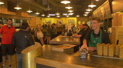 The interior of the first Starbucks in Pike Place, Seattle, Washington - stock footage