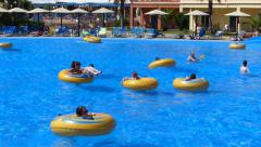 People enjoying in the pool with waves - stock footage