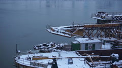 Old ships covered with snow winter on river aerial shot Stock Footage