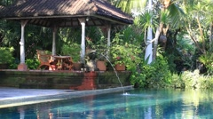 Video 1920x1080  Decorative fountain in swimming pool next the tropical garden. Stock Footage