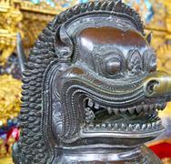 demon in the temple bangkok asia  bronze - stock photo