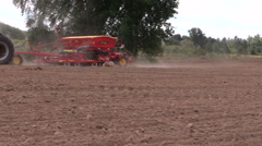Tractor working in field. Time of sowing. Planting crops. Stock Footage