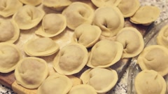 Siberian meat dumplings ready to be cooked Stock Footage