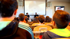 Pupils listen to a lecture of professors at school Stock Footage