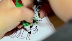 Boy drawing with a felt tip pen on the paper - stock footage