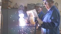 Welder at work in factory Stock Footage