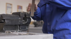 Hands hammering and sawing metal, technician working in a shop Stock Footage