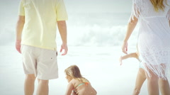 Brazilian family plays together on a beach in Brazil Stock Footage