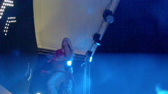 Two club dancers on the stage of summer nightclub Stock Footage