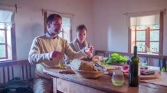 Couple eating local goodness on the countryside Stock Footage