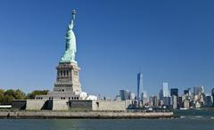 The Statue of Liberty and Manhattan Stock Photos