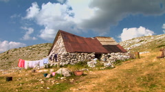 Old stone house in the mountain where people live Stock Footage
