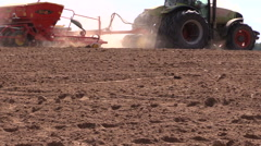 Tractor work in field. Time of sowing. Planting crops Stock Footage