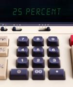 Old calculator showing a percentage - 25 percent Stock Photos
