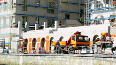 Stock Video Footage of Workers are working on an adaptation of the wall facade of the luxury hotel