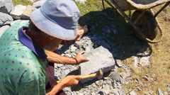 Man manually processing a stone in the quarry Stock Footage
