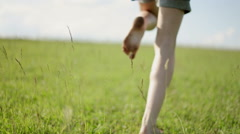 The girl runs barefoot on the grasss Stock Footage