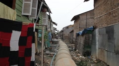Exposed drainage pipe in slum village Cambodia Stock Footage