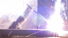 Stock Video Footage of Welder at work in factory