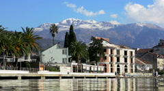 City on the sea coast with view on the snowy mountain peaks Stock Footage