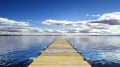 Wooden deck over the sea with scenic view - stock illustration
