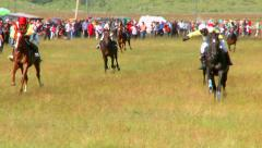 Horses go through the finish line on the mountain horse racing Stock Footage