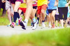 Unidentified marathon racers running Stock Photos