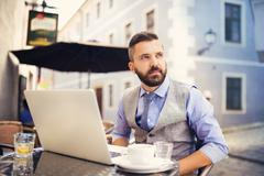 Hipster businessman in cafe - stock photo