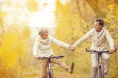 Active seniors riding bike - stock photo