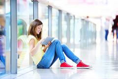 Girl with tablet in shopping mall Stock Photos