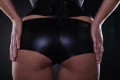 Woman in leather lingerie Stock Photos