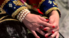 Hands of women dressed in traditional costumes Stock Footage